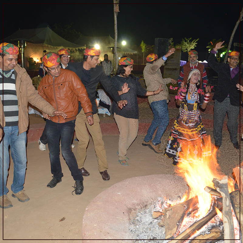 Rajasthani Folk Dance With Bonfire At The Camp Site.